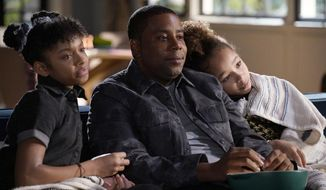 "This image released by NBC shows, from left, Dani Lane as Aubrey, Kenan Thompson as Kenan, and Dannah Lane as Birdie in a scene from the comedy series, ""Kenan,"" premiering on Feb. 16. (Casey Durkin/NBC via AP)"