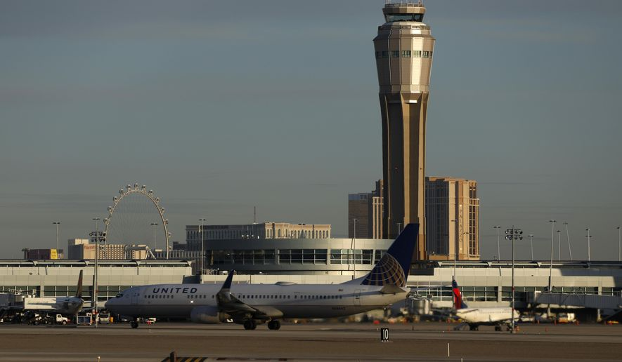 FILE - In this March 19, 2020, file photo a plane takes off at McCarran International airport, in Las Vegas. A county board voted unanimously Tuesday, Feb. 16, 2021, to rename busy McCarran International Airport in Las Vegas after former U.S. Sen. Harry Reid of Nevada. (AP Photo/John Locher, File)