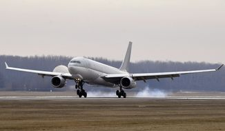 A Hungarian Airbus 330 plane transporting the first batch of the vaccine against the new coronavirus produced by Sinopharm of China to Hungary lands at Budapest Liszt Ferenc International Airport in Budapest, Hungary, Tuesday, Feb. 16, 2021. The vaccine will not be used without its examination and approval by the National Public Health Center. (Zoltan Mathe/MTI via AP)