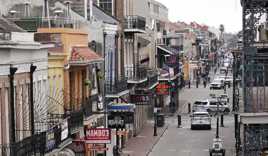 In this file photo, Bourbon Street, which is normally packed with revelers, is seen deserted during Mardi Gras in the French Quarter of New Orleans, Tuesday, Feb. 16, 2021.  (AP Photo/Gerald Herbert)  **FILE**