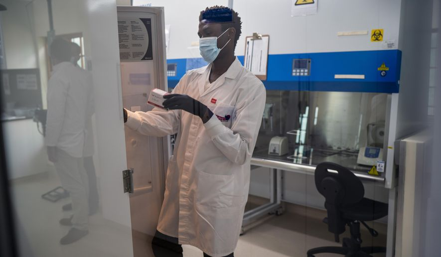 CJ Umunnakw, a virologist, works in the lab at the Ndlovu Care Group in Elandsdoorn, 200 kms north-east of Johannesburg Thursday Feb. 11, 2021. Ndlovu is running a study of the COVID-19 Johnson & Johnson vaccine with 602 people from the community participating. (AP Photo/Jerome Delay)