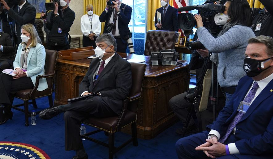 AFL-CIO president Richard Trumka, center, listens as President Joe Biden speaks during a meeting with labor leaders in the Oval Office of the White House, Wednesday, Feb. 17, 2021, in Washington. (AP Photo/Evan Vucci)