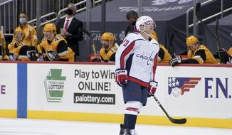 Washington Capitals' Conor Sheary (73) scores as he plays against the Pittsburgh Penguins during an NHL hockey game Tuesday, Feb. 16, 2021, in Pittsburgh. (AP Photo/Keith Srakocic)