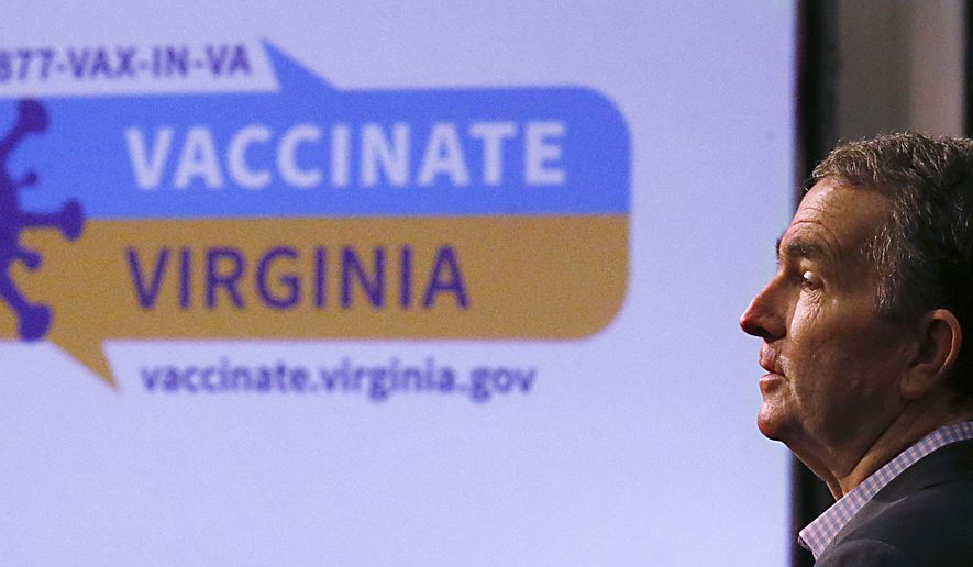 Virginia Gov. Ralph Northam addresses the public and the media while talking about the new website for Virginians to sign up for the COVID-19 vaccination during a press conference at the Patrick Henry Building in Richmond, Va., Wednesday, Feb. 17, 2021. (Bob Brown/Richmond Times-Dispatch via AP)