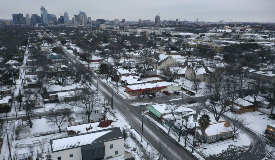 Snow and ice grips a neighborhood in East Austin on Tuesday, Feb. 16, 2021. Day six of the statewide freeze and still millions of Texans are without power. (Bronte Wittpenn /Austin American-Statesman via AP)