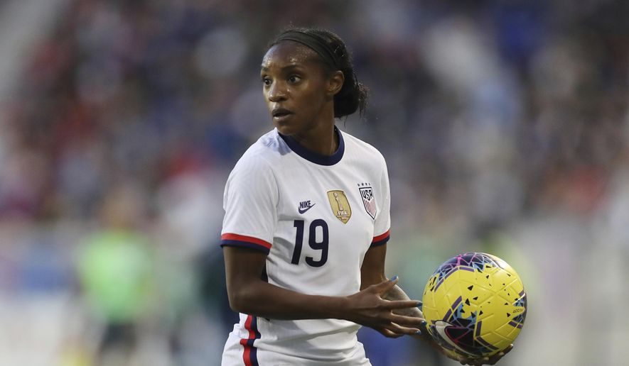 """FILE - United States defender Crystal Dunn (19) looks out before throwing the ball back in during the second half of a SheBelieves Cup soccer match against Spain in Harrison, N.J., in this Sunday, March 8, 2020, file photo. The 28-year-old U.S. national team defender has grown more confident in her abilities and her status on the U.S. women's national team. She's also become empowered in her activism as a Black woman. So much so that she even proclaimed herself the """"New Crystal Dunn."""" (AP Photo/Steve Luciano, File)"""