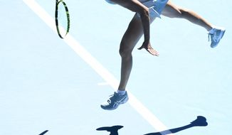 United States' Jennifer Brady serves to compatriot Jessica Pegula during their quarterfinal match at the Australian Open tennis championship in Melbourne, Australia, Wednesday, Feb. 17, 2021.(AP Photo/Andy Brownbill)