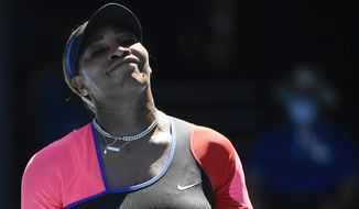 United States' Serena Williams reacts during her semifinal against Japan's Naomi Osaka at the Australian Open tennis championship in Melbourne, Australia, Thursday, Feb. 18, 2021.(AP Photo/Andy Brownbill)
