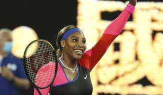 United States' Serena Williams celebrates after defeating Romania's Simona Halep during their quarterfinal match at the Australian Open tennis championship in Melbourne, Australia, Tuesday, Feb. 16, 2021.(AP Photo/Hamish Blair)
