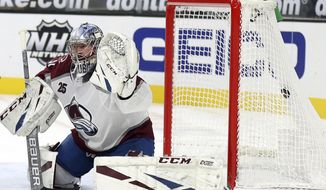 Vegas Golden Knights left wing Max Pacioretty (67) scores on Colorado Avalanche goalie Philipp Grubauer (31) during the second period of an NHL hockey game Tuesday, Feb. 16, 2021, in Las Vegas. (AP Photo/Isaac Brekken)