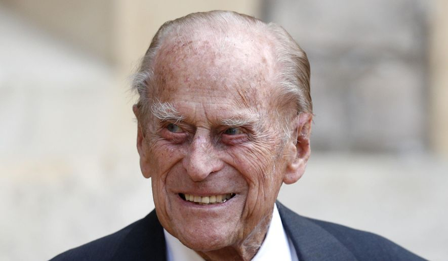 In this Wednesday July 22, 2020 file photo, Britain's Prince Philip arrives for a ceremony for the transfer of the Colonel-in-Chief of the Rifles from himself to Camilla, Duchess of Cornwall, at Windsor Castle, England. Buckingham Palace says 99-year-old Prince Philip has been admitted to a London hospital after feeling unwell. The palace says the husband of Queen Elizabeth II was admitted to the King Edward VII Hospital on the evening of Tuesday Feb. 16, 2021. (Adrian Dennis/Pool via AP, File)