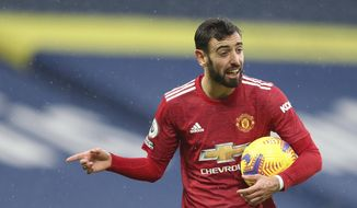Manchester United's Bruno Fernandes gestures during the English Premier League soccer match between West Bromwich Albion and Manchester United at the Hawthorns stadium in West Bromwich, England, Sunday, Feb. 14, 2021. (Naomi Baker/Pool Photo via AP)