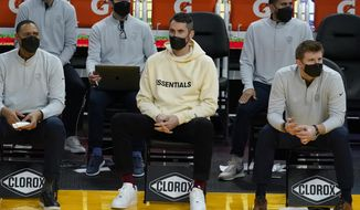 Injured Cleveland Cavaliers forward Kevin Love, middle, watches during the first half of an NBA basketball game against the Golden State Warriors in San Francisco, Monday, Feb. 15, 2021. (AP Photo/Jeff Chiu)