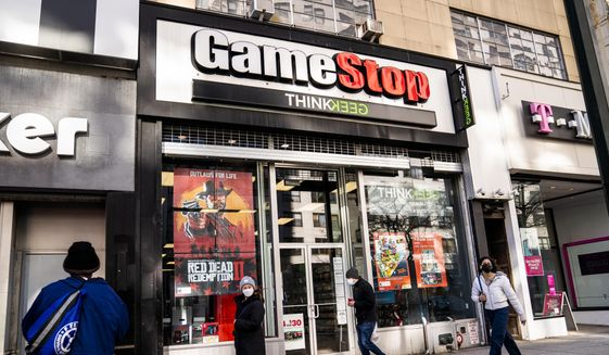 Pedestrians pass a GameStop store on 14th Street at Union Square, Thursday, Jan. 28, 2021, in the Manhattan borough of New York. The GameStop saga has been portrayed as a victory of the little guy over Wall Street giants but not everyone agrees, including some lawmakers in Washington. The House Financial Services Committee is ready to dig into the confounding episode at a hearing on Thursday, Feb. 18. (AP Photo/John Minchillo, File)