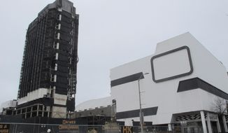 This Feb. 16, 2021 photo shows the former Trump Plaza casino in Atlantic City, N.J. on the day before its main tower, left, was to be imploded. The casino built by former President Donald Trump was once the playground of the rich and famous, but fell into disrepair after shutting down in 2014. (AP Photo/Wayne Parry)