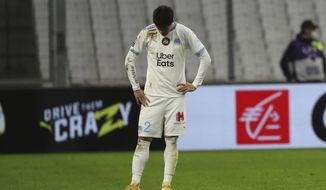 Marseille's Hiroki Sakai gestures end of the French League One soccer match between Olympique de Marseille and Paris Saint-Germain at the Velodrome stadium in Marseille, southern France, Sunday, Feb. 7, 2021. Paris Saint-Germain won 2-0. (AP Photo/Daniel Cole)