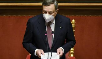 Italy's Prime Minister Mario Draghi addresses the Senatein Rome Wednesday, Feb. 17, 2021, before submitting his government to a vote of confidence. (Alberto Pizzoli/POOL photo via AP)
