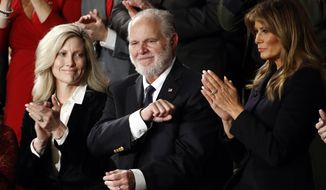 In this Feb. 4, 2020, file photo, Rush Limbaugh reacts as first lady Melania Trump, and his wife Kathryn, applaud, as President Donald Trump delivers his State of the Union address to a joint session of Congress on Capitol Hill in Washington. Limbaugh, the talk radio host who became the voice of American conservatism, died on Feb. 17, 2021, of lung cancer. (AP Photo/Patrick Semansky, File)