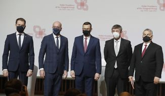 Prime ministers from central Europe Igor Matovic of Slovakia, left; Mateusz Morawiecki of Poland, center; The Czech Republic's Andrej Babis, second right and Viktor Orban of Hungary, right, with European Council President Charles Michel, second left, taking a family photo following a news conference at a meeting marking 30 years of central Europe's informal body of cooperation called the Visegrad Group, at a conference center in Krakow, Poland, Wednesday, Feb. 17, 2021.(AP Photo/Czarek Sokolowski)