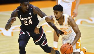 South Carolina's Keyshawn Bryant (24) defends against Tennessee's Victor Bailey Jr. (12) during an NCAA college basketball game Wednesday, Feb. 17, 2021, in Knoxville, Tenn. (Brianna Paciorka/Knoxville News Sentinel via AP, Pool)