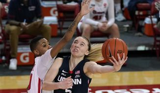 St. John's guard Kadaja Bailey (30) fouls Connecticut guard Paige Bueckers (5) during the second quarter of an NCAA college basketball game Wednesday, Feb. 17, 2021, in New York. (AP Photo/Kathy Willens)