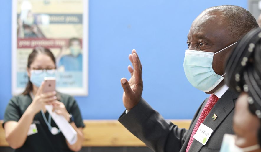 South African President Cyril Ramaphosa arrives at a hospital in Khayelitsha, Cape Town, South Africa Wednesday, Feb. 17, 2021, to receive a Johnson and Johnson vaccine. Ramaphosa was among the first in his country to receive the COVID-19 vaccination to launch the inoculation drive. (AP Photo/Nardus Engelbrecht)