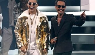 Daddy Yankee, left, and Marc Anthony perform at Premio Lo Nuestro at American Airlines Arena, Tuesday, Feb. 16, 2021, in Miami. The award show airs on Feb. 18 with both live and prerecorded segments. (AP Photo/Lynne Sladky)