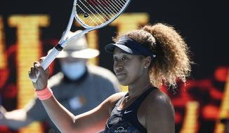 Japan's Naomi Osaka celebrates after defeating United States' Serena Williams in their semifinal match at the Australian Open tennis championship in Melbourne, Australia, Thursday, Feb. 18, 2021.(AP Photo/Andy Brownbill) **FILE**