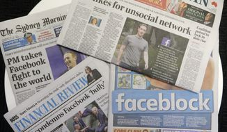 Front pages of Australian newspapers are displayed featuring stories about Facebook in Sydney, Friday, Feb. 19, 2021. In a surprise retaliatory move Thursday, Facebook blocked Australians from sharing news stories, escalating a fight with the government over whether powerful tech companies should have to pay news organizations for content. (AP Photo/Rick Rycroft)