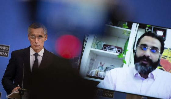 NATO Secretary General Jens Stoltenberg speaks during a media conference, after a meeting of NATO defense ministers in video format, at NATO headquarters in Brussels on Thursday, Feb. 18, 2021. (AP Photo/Virginia Mayo, Pool)