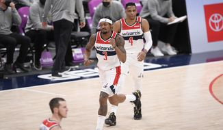 Washington Wizards guard Bradley Beal (3) reacts next to guard Russell Westbrook (4) during the second half of an NBA basketball game against the Denver Nuggets, Wednesday, Feb. 17, 2021, in Washington. (AP Photo/Nick Wass) **FILE**
