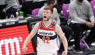 Washington Wizards forward Davis Bertans (42) reacts after he made a three-point basket during the second half of an NBA basketball game against the Denver Nuggets, Wednesday, Feb. 17, 2021, in Washington. (AP Photo/Nick Wass) **FILE**