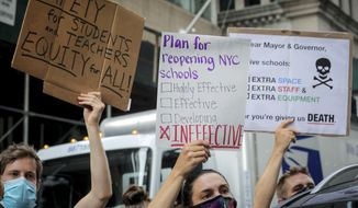 In this Aug. 3, 2020, file photo, a coalition of teachers, students, and families protest during a rally called National Day of Resistance Against Unsafe School Reopening Opening, in New York.  (AP Photo/Bebeto Matthews, File)