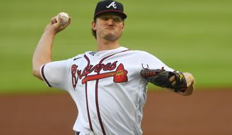 FILE - In this July 29, 2020, file photo, Atlanta Braves' Mike Soroka throws a pitch during the second inning of the baseball team's home-opener, against the Tampa Bay Rays in Atlanta. St. Louis pitcher Jack Flaherty and Soroka won their salary arbitration cases on Saturday, Feb. 13, 2021, and Tampa Bay reliever Ryan Yarbrough lost. (AP Photo/John Amis, File)