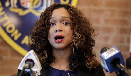 In this Tuesday, Dec. 3, 2019, file photo, Maryland State Attorney Marilyn Mosby speaks during a news conference in Baltimore. (AP Photo/Julio Cortez, File)