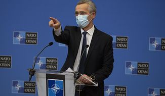 NATO Secretary General Jens Stoltenberg wears a protective face mask as he prepares to speak during a media conference, after a meeting of NATO defense ministers in video format, at NATO headquarters in Brussels on Thursday, Feb. 18, 2021. (AP Photo/Virginia Mayo, Pool)