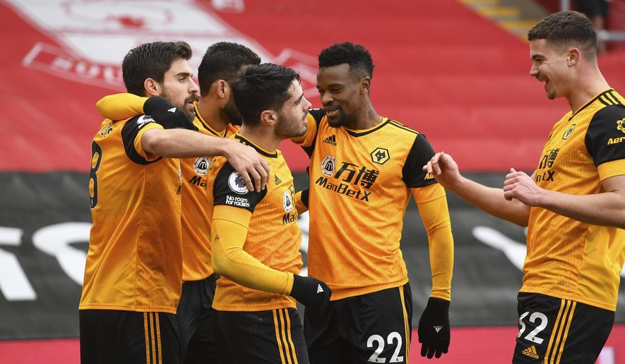 Wolverhampton Wanderers' Pedro Neto celebrates scoring their second goal during the English Premier League soccer match between Wolverhampton Wanderers and Southampton at St. Mary's Stadium in Southampton, England, Sunday, Feb.14, 2021.(Andy Rain/Pool via AP)