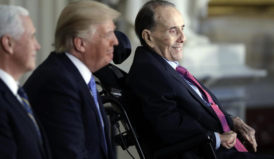 In this Jan. 17, 2018, file photo, President Donald Trump, center and Vice President Mike Pence watch during a Congressional Gold Medal ceremony honoring former Sen. Bob Dole on Capitol Hill in Washington. (AP Photo/Evan Vucci)