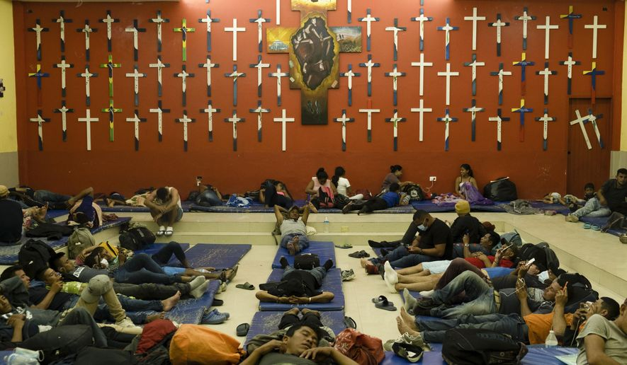 "Central American migrants rest at ""The 72"" shelter in Tenosique, Tabasco state, Mexico, Tuesday, Feb. 9, 2021. Only six weeks into the year, the shelter has hosted nearly 1,500 migrants compared to 3,000 all of last year, even though it has halved its dormitory capacity due to the new cornavirus pandemic. (AP Photo/Isabel Mateos)"