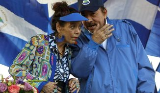 FILE - In this Sept. 5, 2018 file photo, Nicaragua's President Daniel Ortega and his wife and Vice President Rosario Murillo, lead a rally in Managua, Nicaragua. The Central American country has created a National Ministry for Extraterrestrial Space Affairs, The Moon and Other Celestial Bodies. The new agency was approved on Wednesday, Feb. 17, 2021, by 76 legislators in the country's congress, which is dominated by President Daniel Ortega's Sandinista Party. (AP Photo/Alfredo Zuniga, File)