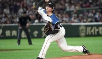 FILE - In this March 17, 2019, file photo, Nippon Ham Fighters starter Kohei Arihara pitches against the Oakland Athletics in the first inning of an exhibition baseball game on Tokyo.  Arihara says he settled on the Texas Rangers because they told right-hander what they thought he could do better in addition to mentioning the things they liked. The process of working on some of those things has started with pitchers and catchers officially reporting to spring training in Arizona. (AP Photo/Eugene Hoshiko, File)