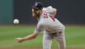 FILE - Boston Red Sox starting pitcher Chris Sale delivers in the first inning of the team's baseball game against the Cleveland Indians in Cleveland, in this Tuesday, Aug. 13, 2019, file photo. Chris Sale is getting closer to getting back on the mound following Tommy John surgery in March. The 31-year-old was the only player at the team's facility in Florida for months as he began his rehab this offseason. He's had a few hiccups, including a brief bout with COVID-19 and a neck injury. But as the team joined him to open spring training on Thursday, Feb. 18, 2021, he says he's methodically working his way through his throwing program he isn't thinking beyond the next day as he looks to make a midseason return. (AP Photo/Tony Dejak, FIle)