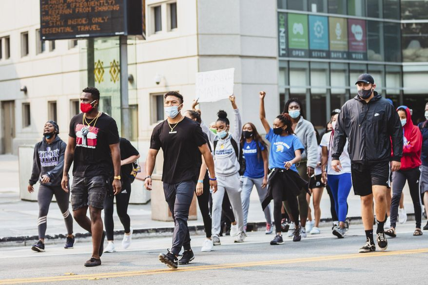 In this Sept. 1, 2020 photo, student-athletes from San Jose State University march from their campus to City Hall to bring awareness to issues of social injustice in San Jose, California. Student-athletes across college campuses are taking a lead from professional athletes by using their platforms in hopes of creating change. (Aubrey Tibbils, San Jose State University Athletics via AP)