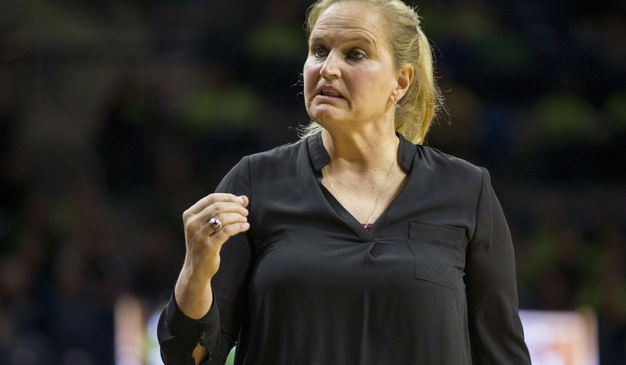 FILE - In this Nov. 14, 2016, file photo, Fordham coach Stephanie Gaitley looks to her bench during the first half of an NCAA college basketball game, in South Bend, Ind. The Fordham women's basketball team isn't happy that the athletic department is on pause because of high coronavirus numbers at the school. The team started a petition to try and get the school to change it's mind and allow the team to play its games on the road after the team hasn't had a positive COVID-19 test the entire season. . (AP Photo/Robert Franklin, File)