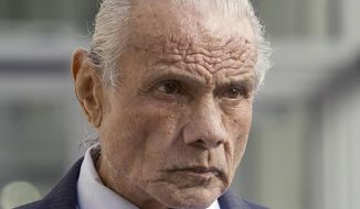 """FILE - In this Nov. 2, 2015, file photo, former professional wrestler Jimmy """"Superfly"""" Snuka leaves after his formal arraignment at the Lehigh County Courthouse in Allentown, Pa. Snuka is among dozens of former pro wrestlers, named as plaintiffs in lawsuits charging that World Wrestling Entertainment failed to protect them from repeated head injuries, who are taking their case to the U.S. Supreme Court. (Michael Kubel/The Morning Call via AP, File)"""