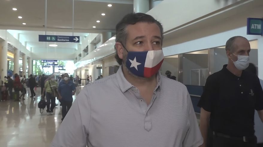 In this image from video, Sen. Ted Cruz, R-Texas, walks to check in for his flight back to the U.S., at Cancun International Airport in Cancun, Mexico, Thursday, Feb. 18, 2021. (AP Photo/Dan Christian Rojas)