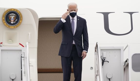 President Joe Biden salutes from the top of the steps of Air Force One at Andrews Air Force Base, Md., Friday, Feb. 19, 2021. Biden is heading to Michigan to visit a Pfizer vaccine manufacturing plant near Kalamazoo. (AP Photo/Susan Walsh)