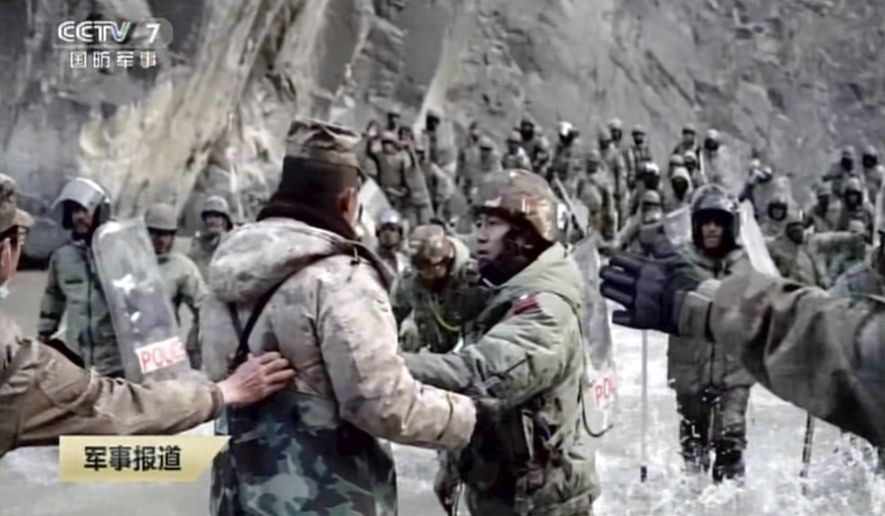 In this image taken from video footage run Feb. 19, 2021, by China's CCTV via AP Video, Indian and Chinese troops face off in the Galwan Valley on the disputed border between China and India, June 15, 2020. China's military said Friday, Feb. 19, 2021, that four of its soldiers were killed in a high-mountain border clash with Indian forces last year, the first time Beijing has publicly conceded its side suffered casualties in the deadliest incident between the Asian giants in nearly 45 years. (CCTV via AP Video)