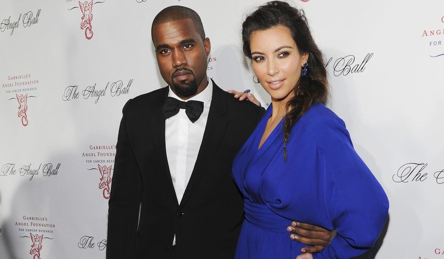 Kanye West, left, and Kim Kardashian attend Gabrielle's Angel Foundation Angel Ball cancer research benefit on Oct. 22, 2012, in New York. Kim Kardashian West filed for divorce Friday, Feb. 19, 2021, from Kanye West after 6 1/2 years of marriage. Sources familiar with the filing but not authorized to speak publicly confirmed that Kardashian filed for divorce in Los Angeles Superior Court. The filing was not immediately available. (Photo by Evan Agostini/Invision/AP, File