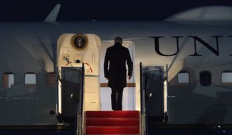 President Joe Biden boards Air Force One, at Andrews Air Force Base, Md., Friday, Feb. 12, 2021, en route to Camp David. (AP Photo/Jacquelyn Martin)